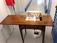Singer Sewing Machine in solid walnut cabinet w foot pedal from 1968  Plainville