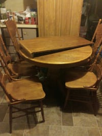 round brown wooden pedestal table with chairs dining set