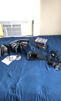 PS2 slim with all cables, 1 controller, and 30+ games