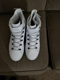 pair of white lace-up high-top sneakers. 10.5