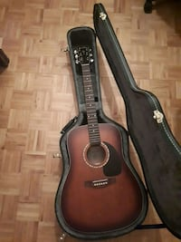 brown acoustic guitar with case Montréal, H4N 1Y9