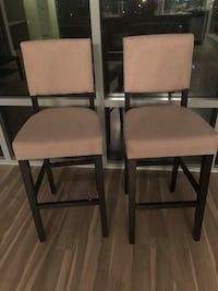 Two tan high chairs. Less than 1 yr old.  25 km