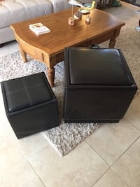 two black leather ottoman chairs