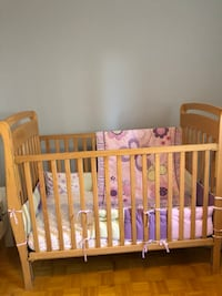 baby's brown wooden crib 538 km
