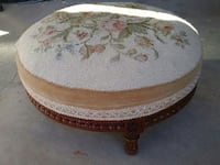 round beige and green floral ottoman