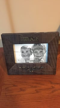 brown wooden friends photo frame London, N5Y 3N1