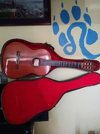 red classical guitar in case Richmond, 94801