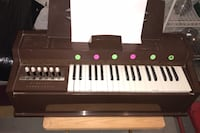 "Table top chord organ.   Works great plug in.    28""-12"". brown."
