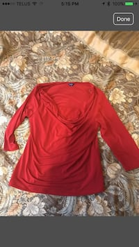 Red plunging neck top.