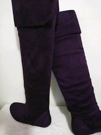 pair of black knee-high boots Cocoa