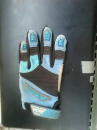 unpaired blue and black Fly glove