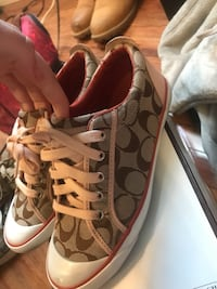 pair of brown monogram Coach low-top shoes Stockton, 95206