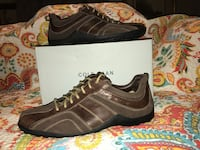 Pair of black-and-brown Cole Hann - Nike cross overs sneakers Houston, 77055