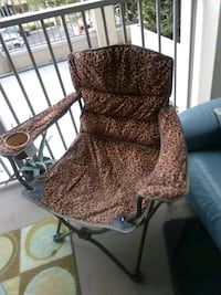 brown and black padded armchair Charlotte