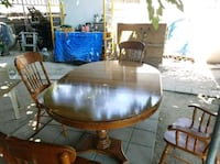 round brown wooden table with four chairs dining set 2337 mi