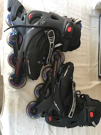 Pair of black-and-red inline skates, women's size 8, barely used Mississauga, L5N