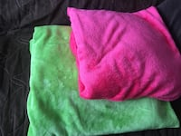 two pink and green blankets $10 each  530 km