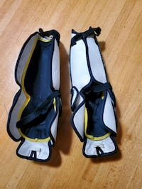 Hockey leg protection guards. One elastic has been cut.
