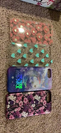 Four assorted-color iphone cases