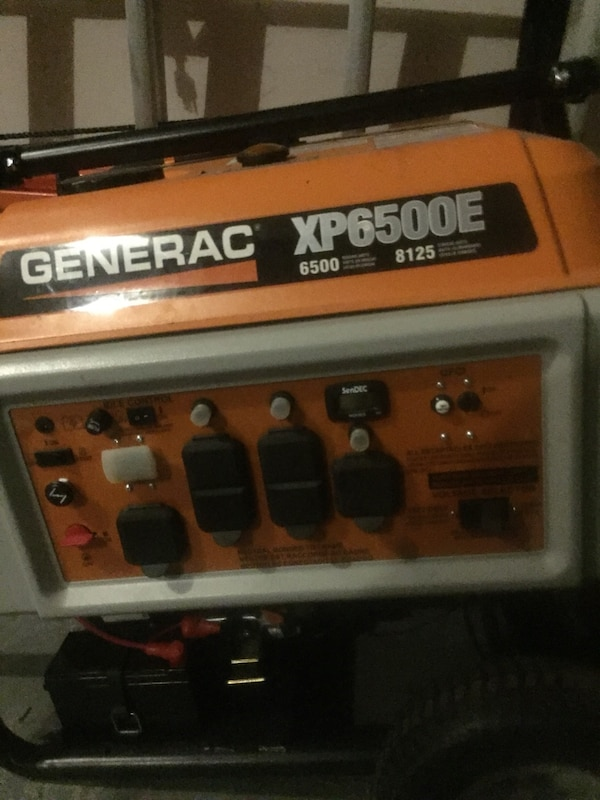 black and orange Generac portable generator