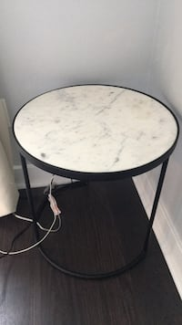 round black wooden table with gray metal base Toronto, M6K 3R9