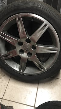 Chrome 5-spoke car wheel with tire