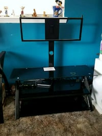 black flat screen TV with black TV stand Boise, 83704
