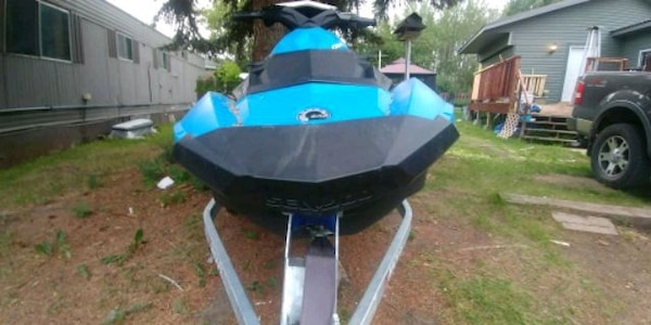 blue and black motor boat