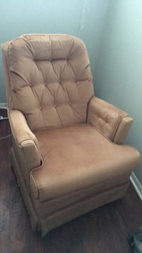 Brown leather padded sofa chair Cleveland