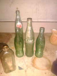 three green and one brown glass bottles Hendersonville, 28792