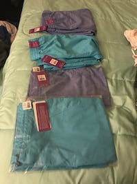 DENTAL SCRUBS- purple label - style 9095- color torquiose and Cril- size medium- never used 43 km