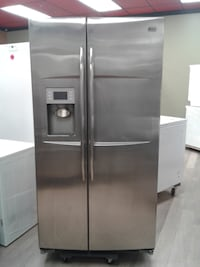 silver side-by-side refrigerator with dispenser null