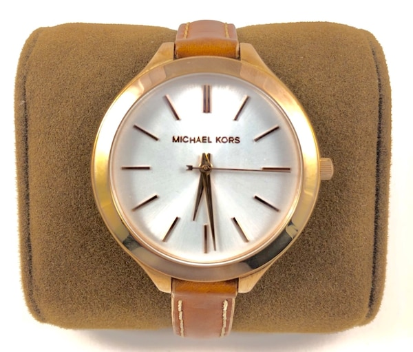 round gold Michael Kors analog watch with brown leather strap 3