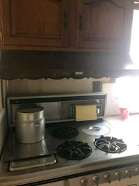 black and gray gas range oven Queens, 11105