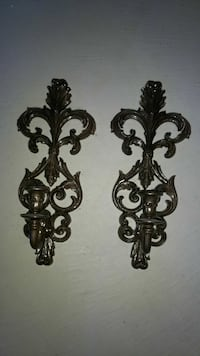 two brown baroque sconces