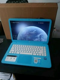 Blue and white HP laptop
