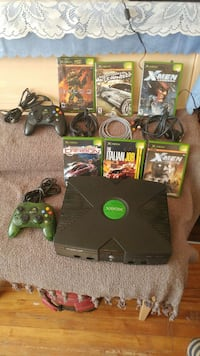 black Xbox 360 console with controllers and game cases Beauharnois, J6N 2B9
