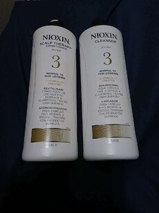 two Nioxin Cleanser bottles