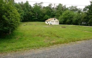 Great location half acre lot for sale by owner