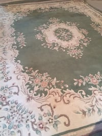 white, maroon ,brown and green floral area rug