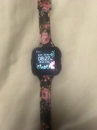 Black and pink floral print Fitbit versa. With silver screen protector. Hamilton, 45013