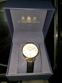 round gold analog watch with black leather strap i