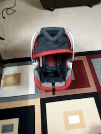 baby's red and black car seat carrier London, N6H 4R5
