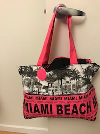 red and white leather tote bag