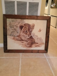 Brown wooden framed painting of woman Jackson, 08527