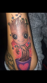 Griot hand size full color tattoo Laurel, 20707