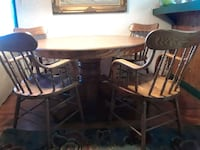 round brown wooden table with four chairs dining set Thousand Oaks, 91360
