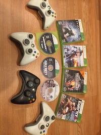 Xbox 360 game controllers and game cases