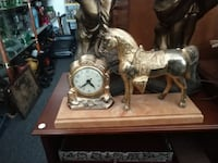 silver-colored framed analog watch beside horse figurine Odenton, 21113