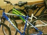 green and blue mountain bikes